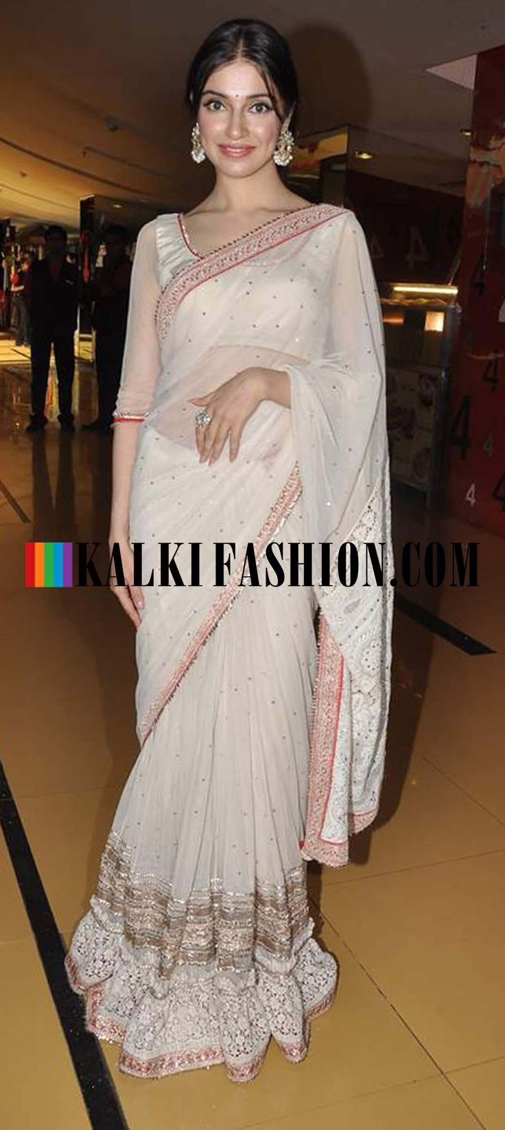 http://www.kalkifashion.com/   Divya Kumar in a cream saree at the trailer launch of her upcoming movie Yaariyan