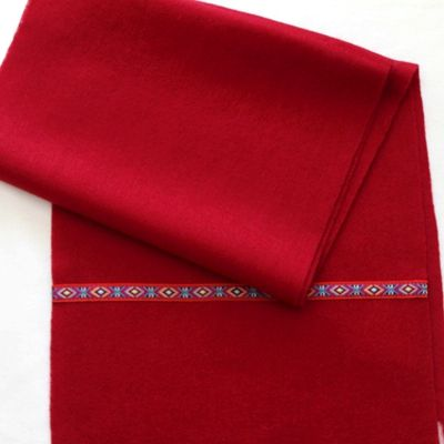A soft wool scarf is crafted with a tribe purflie to added casual-chic appeal. The twill weave gives it thin but warm touch. A timeless classic outerwear essential. Long enough to wear in many different ways, The color is a rich deep red (it is not as bright a red that is pictured).