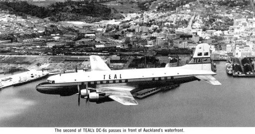 TEAL, DC-6 over flying Auckland City waterfront
