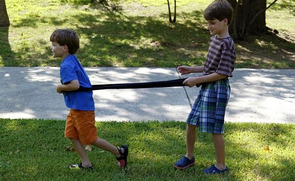 Dye-namic stretch band connects two kids & provides resistance as they move.  It's a 6 foot spandex-like fabric sewed into a continuous circle. (link provided).  They have to coordinate their movements through games, activities, an obstacle course...  Great for kids who need a bit of focus or a lesson in cooperation.
