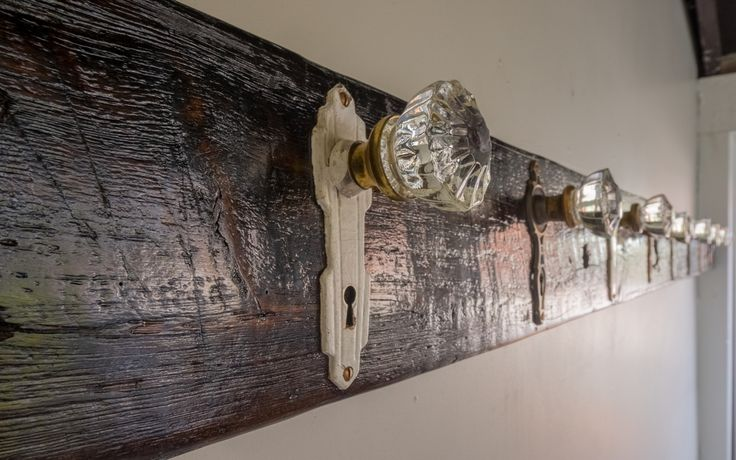 DIY Reclaimed Barn Beam with Antique Doorknobs coat rack