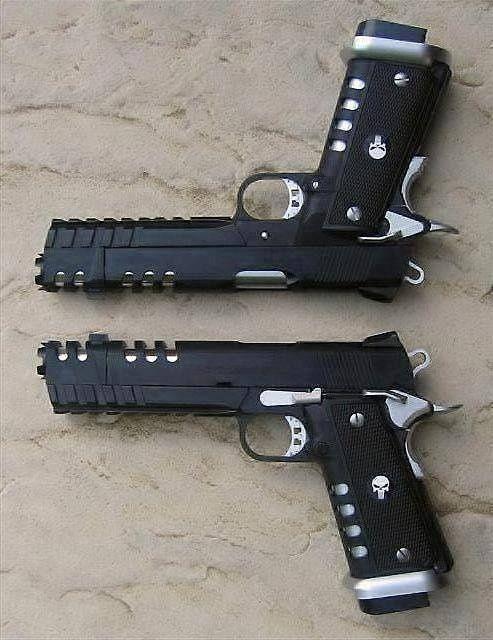 Dual 1911's w/ Punisher skulls on grips