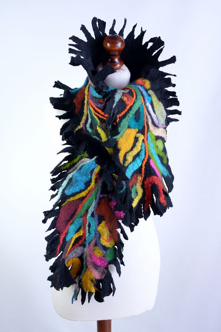 Colorful felt shawl with beautiful fringe design and rainbow tones made of merino wool. You can wrap in it and feel cozy, safe and very attractive! #scarf #multicolor #warm_scarf #winter_scarf #wool_scarf #felt_scarf #felted_scarves