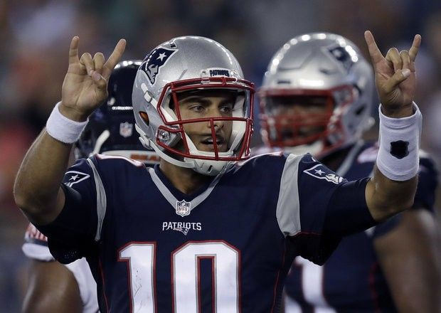 New England Patriots quarterback Jimmy Garoppolo (10) signals to teammates during the second half of a preseason NFL football game against the Chicago Bears Thursday, Aug. 18, 2016, in Foxborough, Mass. (AP Photo/Charles Krupa)