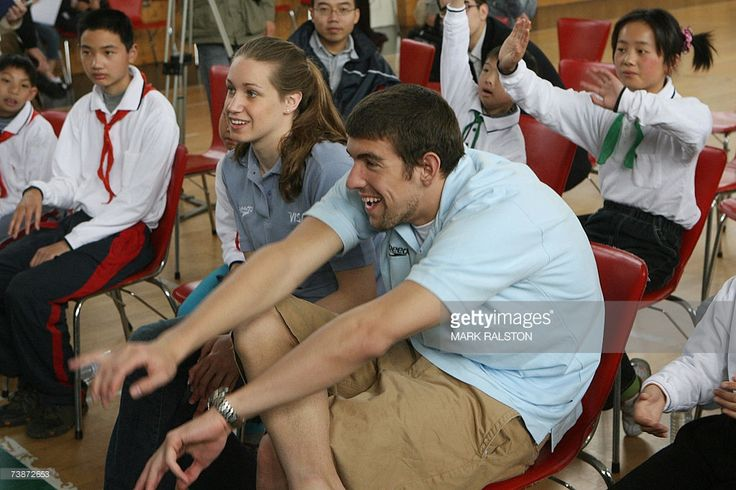 Olympic and World Swimming champions Katie Hoff and Michael Phelps, watch as disabled students from the Pudong Special Needs School practice judo in Shanghai, 13 April 2007. Phelps and Hoff are in Shanghai on a goodwill tour to promote the 2007 Special Olympics to be held in October. AFP PHOTO/Mark RALSTON