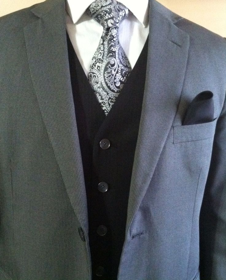 Love the dark vest with the grey suit...great contrast!