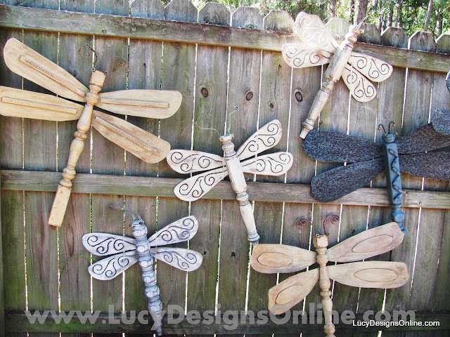 Dragonflies made from table legs and ceiling fan blades. I have the back side of my neighbors fence...Great Idea