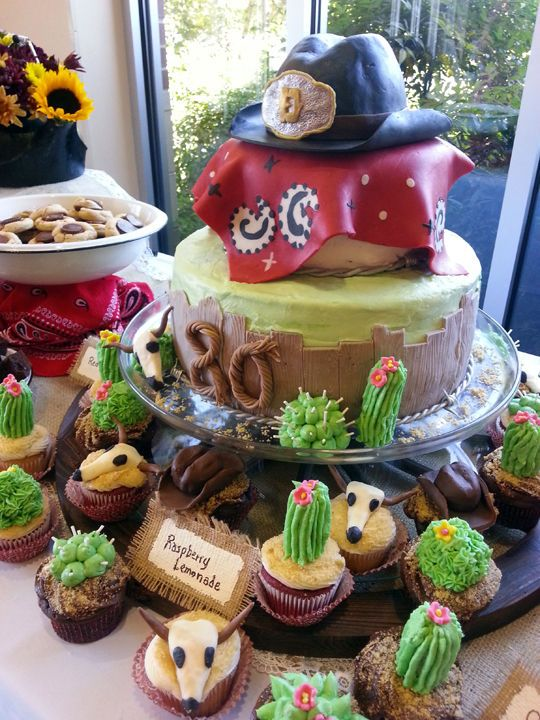 This one I did... Western theme adult birthday cake displayed with cupcakes- carrot cake bottom tier, chocolate top tier; chocolate cupcakes with chocolate chip cookie dough filling; lemo...