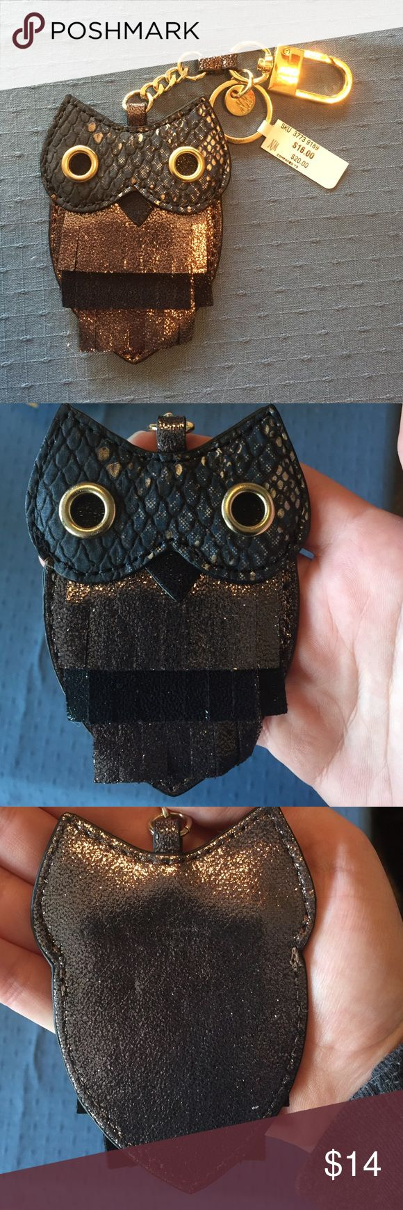 Neiman Marcus owl keychain Received as a gift and it's just too big for me to carry around with all the keys I have. I suspect it's faux leather, no material info on the tag. Offers welcome. No trades or off posh sales. Neiman Marcus Accessories Key & Card Holders