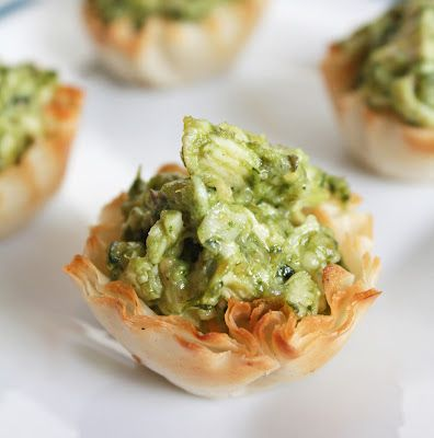 Cheesy Chicken Pesto Cups Makes 15 phyllo cups - 3 carbs             3/4 c  ch  cook  chicken  2 T  prep  pesto  1 T  mayo   1 T  grate  Rom or Parm  cheese  1 pack  Athens phyllo cups                 first 4 ingred.  salt or pepper . add . 1 T of chick  mix    cups.  Bake  375  .8 min  Good hot or cold.