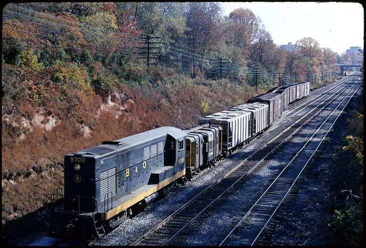 B&O H-10-44 #9700 Brings cars across the Met. (Dec 1967) #9700 was built in 1948 as an order of 10 H-10-44's from Fairbanks-Morse.