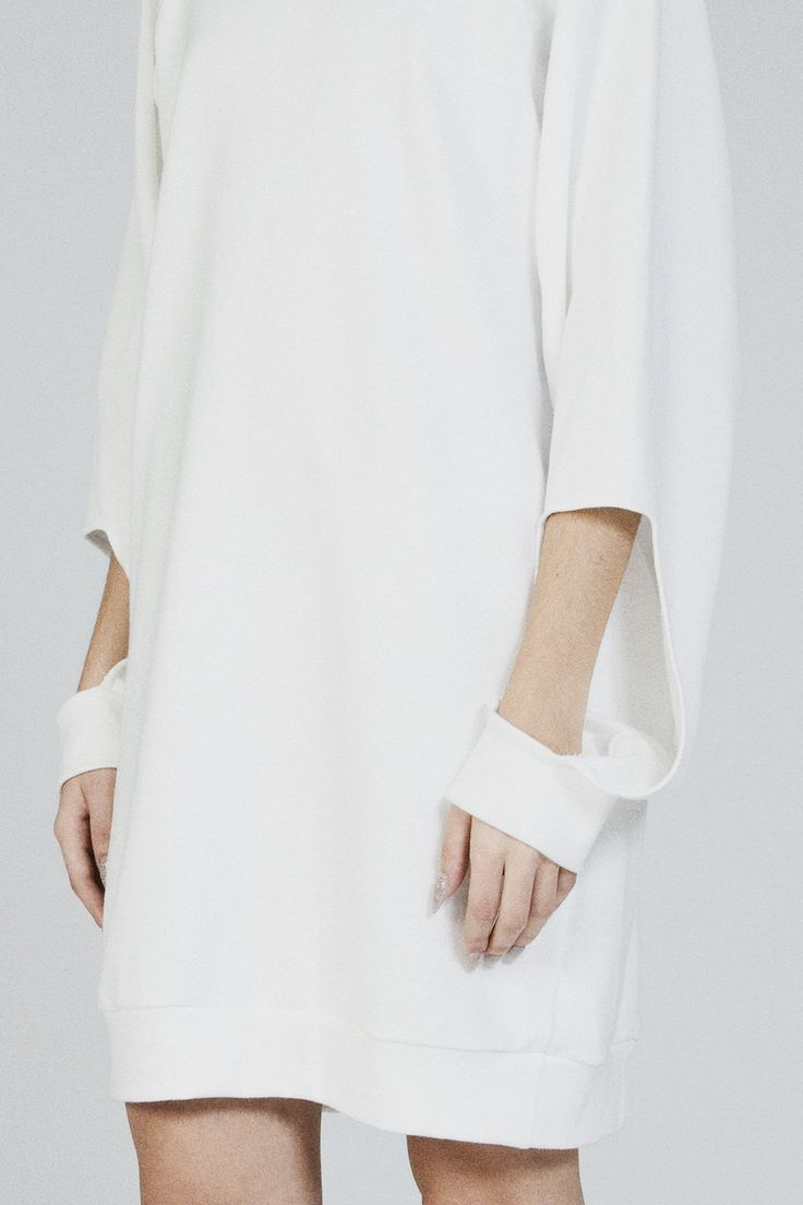 White dress with cut out sleeve detail; pattern cutting; minimal fashion // Michael Metric