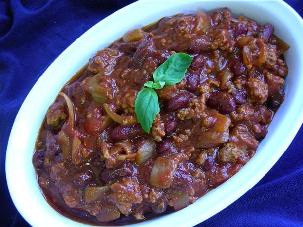 Great chili recipe.  I chunk up lean pork and beef instead of using ground beef.  I also use esspresso for strong coffee, and whatever beer I have in the house (not light beer!) I also add worcestershire sauce.  Adjust spice amounts to perfect the taste.