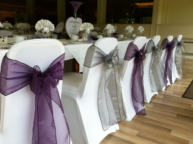 Plum chair bows, maybe with a little orange flower or glittery orange leaves in the center of the bow?  platinum and plum wedding | Gallery | Table Angels