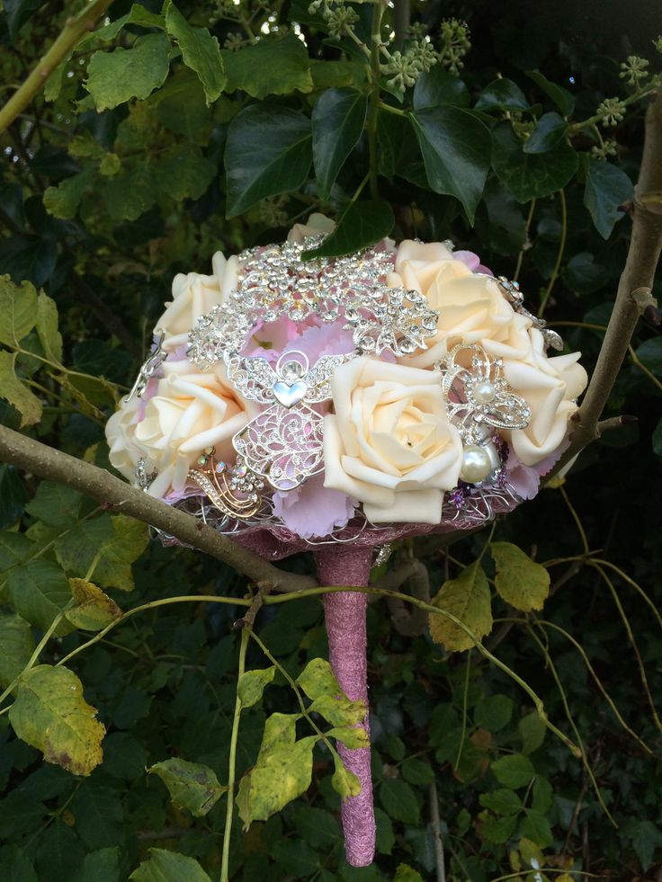 Pink Based Tones With Ivory Roses In This Heirloom Brooch Bouquet