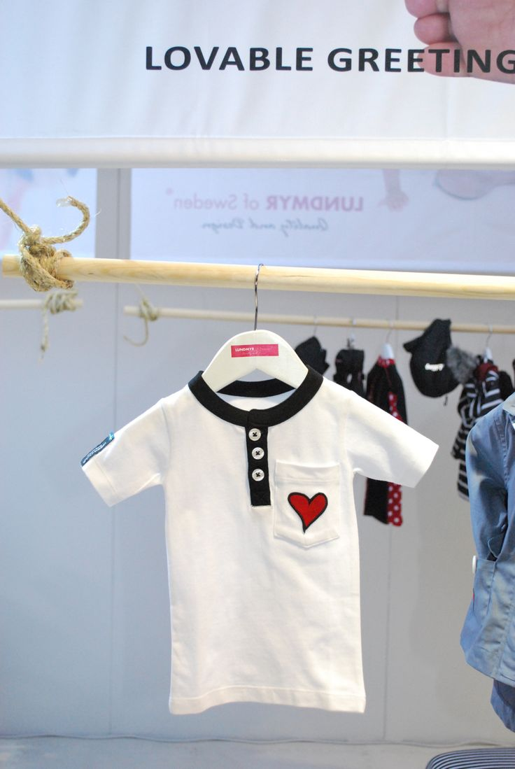 White shirt with short sleeve with red heart patch on pocket. Available in size 0-2,years.