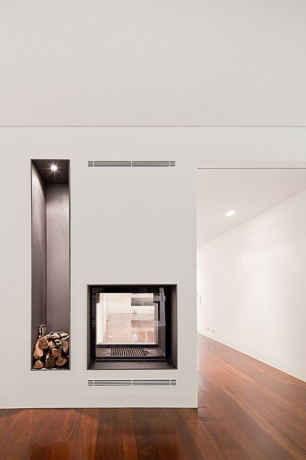 Cool how this fireplace also becomes a window between spaces...