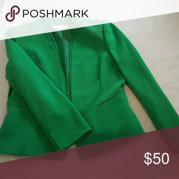 Green suit jacket from Tahari - unique! Bright green suit jacket with small shoulder pads. Beautiful structured fabric. Tahari Jackets & Coats Blazers