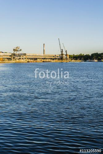 """Pobierz zdjęcie royalty free  """"Port infrastructure over the Dead Vistula."""" autorstwa gubernat w najniższej cenie na Fotolia.com. Przeglądaj naszą bazę tanich obrazów online i odnajdź doskonałe zdjęcie stockowe do Twoich projektów reklamowych!"""