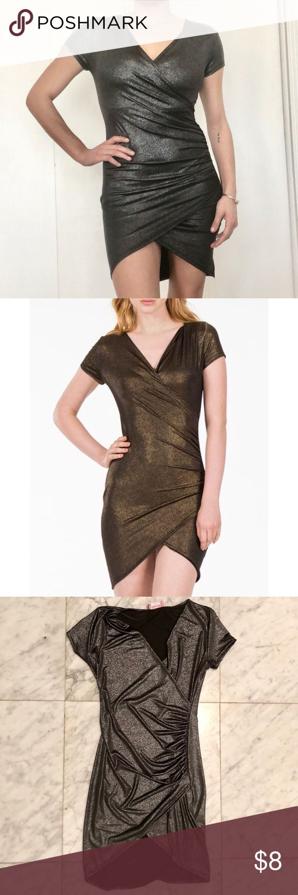 *NYE* Metallic Wrap Dress Short sleeve v-neck metallic gun metal silver bodycon dress with asymmetrical hem and rouching detail. Never been worn. Sample. Size Small *IMAGES FROM WEBSITE ARE FOR GOLD COLOR - DRESS BEING SOLD IS GUN METAL SILVER* Dresses