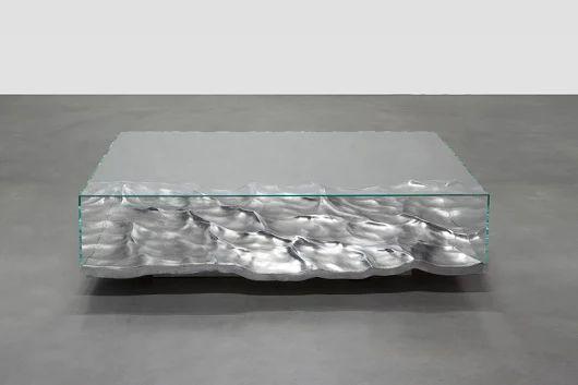 mathieu lehanneur fossilizes liquid marble + aluminum in table collection
