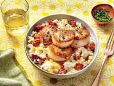 Creamy Rice with Scallops Recipe | This recipe is impressive enough for company but easy enough for a weeknight. Smoky, salty bacon tastes delicious with naturally sweet foods like corn and scallops. Here, we combined all three ingredients in this sophisticated risotto-like dish made with Arborio rice. We recommend sea scallops for this recipe. The smaller bay scallops are not large enough to get a good sear without overcooking. For a crisp, golden brown sear, ensure the pan is very hot and…
