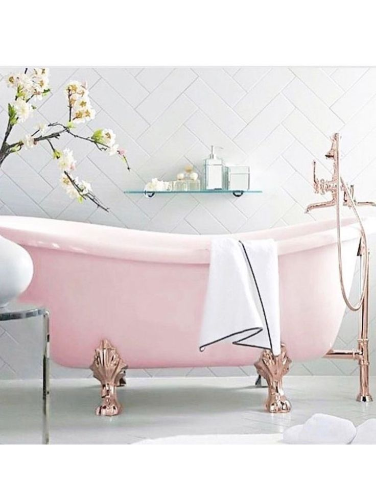 Pink tub rose gold feet and plumbing