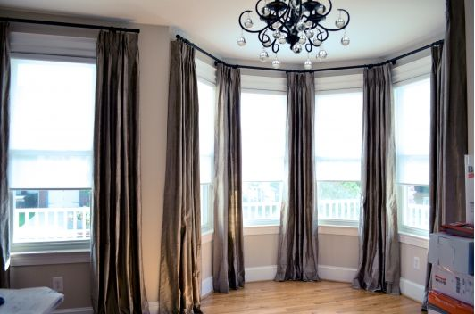 not necessarily this color scheme (or the window set up) but the placement and scale of the drapes make the space seem taller and larger with the rod placed all the way to the ceiling and the panels flanking the windows.