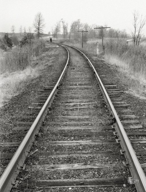 """The Traveler: January 1939. """"Railroad tracks. Williamson County, Illinois."""" Photo by Arthur Rothstein for the Resettlement Administration."""