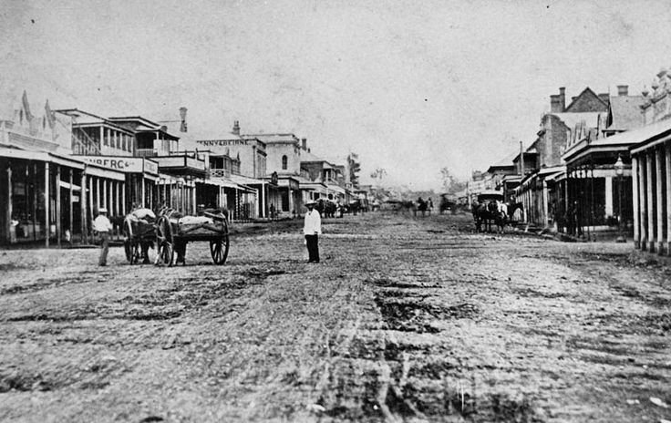 Ruthven Street, Toowoomba, ca. 1881 - Pedestrians and horsedrawn vehicles are visible in the street.