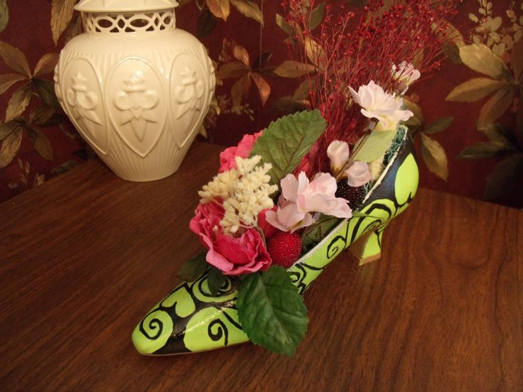 handpainted satin shoe  filled with flowers