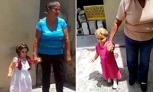 The life-size doll, wearing a white and pink dress with its blonde hair in pigtails, mysteriously strolls with an elderly woman in the courtyard of a house in Saltillo, Mexico.
