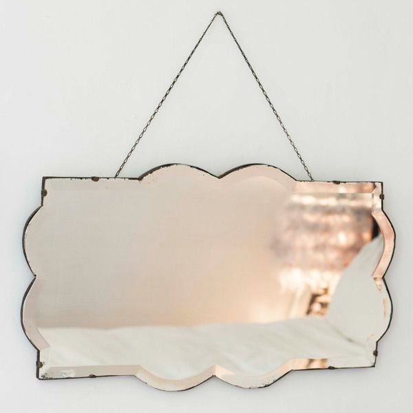 This vintage curved frameless mirror is one of the loveliest we've seen. Perfect for adding an original sillhouette into a feature wall of frameless mirrors #vintage #mirrors