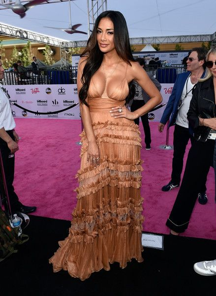 """Singer Nicole Scherzinger poses at SiriusXM's """"Hits 1 in Hollywood"""" red carpet broadcast on SiriusXM's SiriusXM Hits 1 channel before the Billboard Music Awards at the T-Mobile Arena on May 21, 2017 in Las Vegas, Nevada."""
