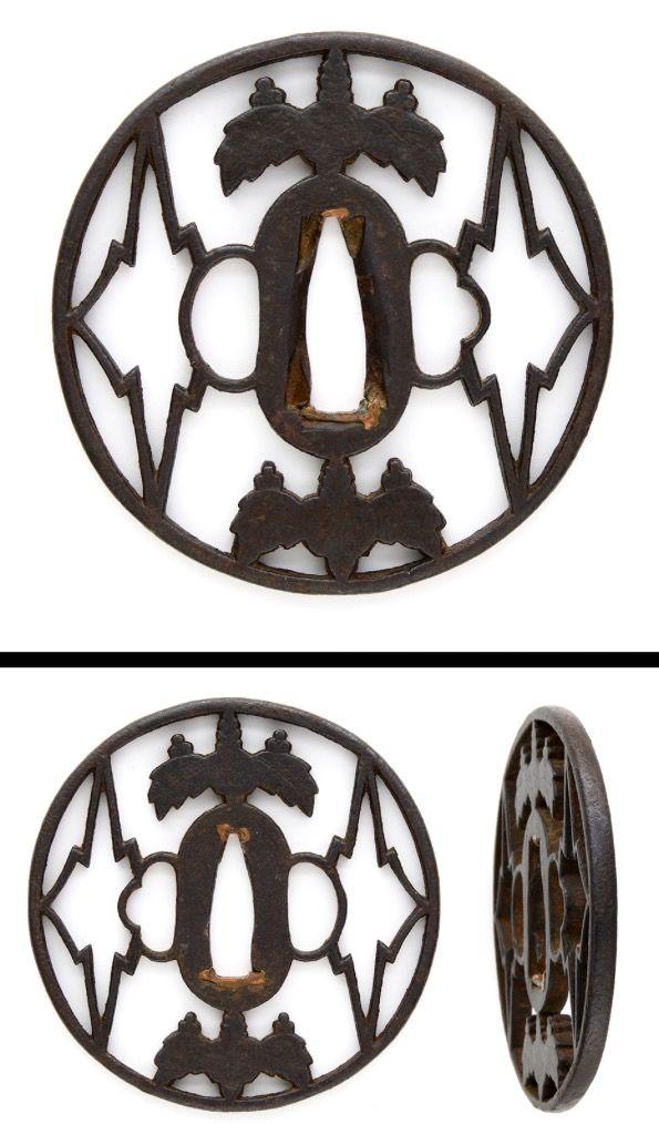 Late Kamakura period Hollyhock and pine engraved open work on round shape iron Tsuba