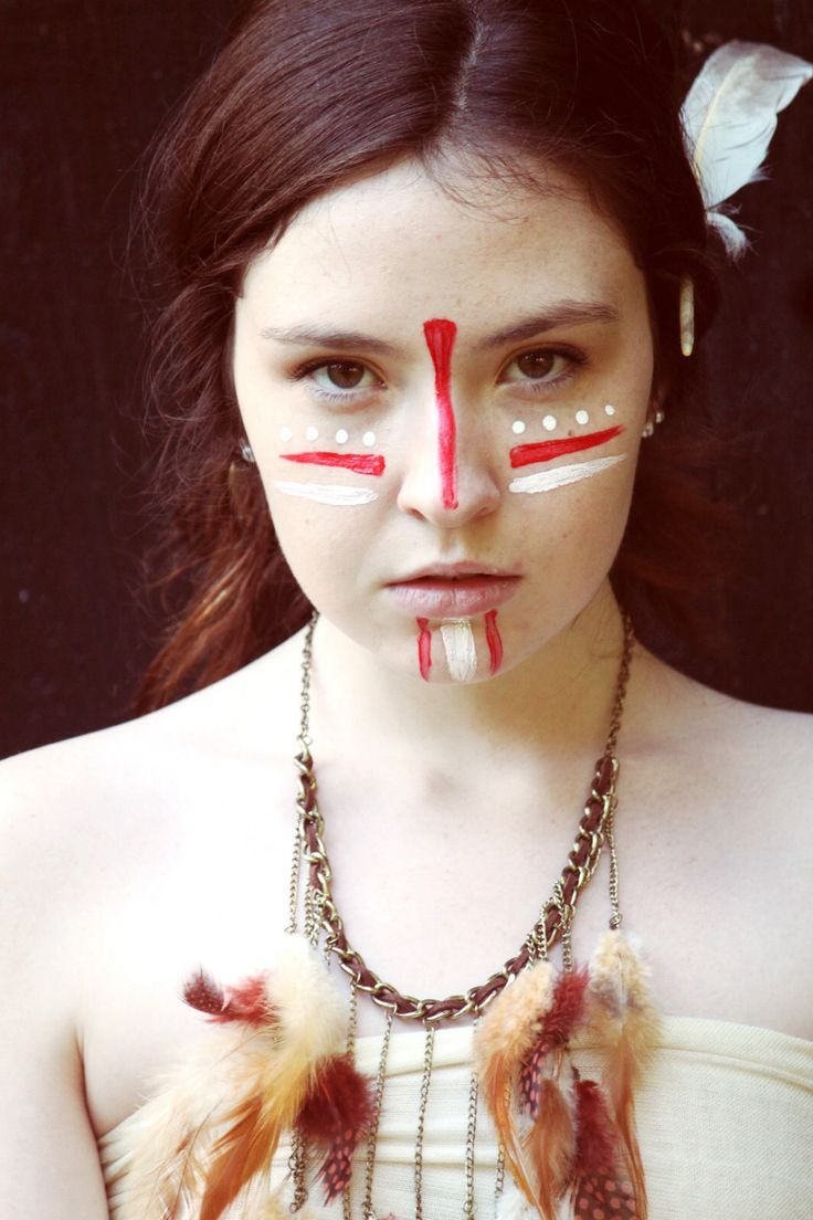 red and white stripe on cheeks Pale Indian. Neat face paint.