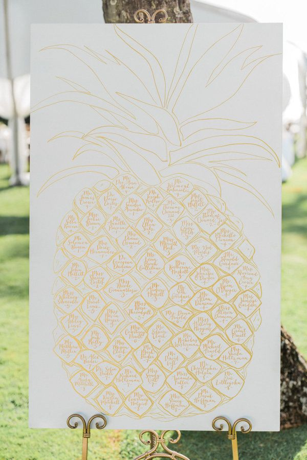 Pineapple escort card wedding sign:  http://www.stylemepretty.com/little-black-book-blog/2016/08/05/destination-hawaiian-wedding-dreams-made-of-these/ | Photography: Troy Grovers - http://blog.troygrover.com/