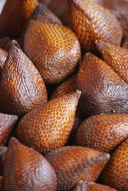 Salak - native to Indonesia, Brunei and Malaysia. The fruit grow in clusters at the base of the palm. Snakeskin fruit.