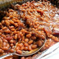 Cheater Baked Beans ~ Super Easy: 2 cans Bush's, 2/3 cup brown sugar, 1/3 cup ketchup, 1/8 tsp garlic powder, 1 small onion, worchestershire and/or liquid smoke to taste - mix all ingredients in baking dish - add bacon - cook 350 uncovered for about an hour