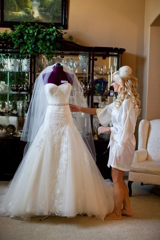 Bride must-have wedding picture with her bridal gown in the morning of wedding day!