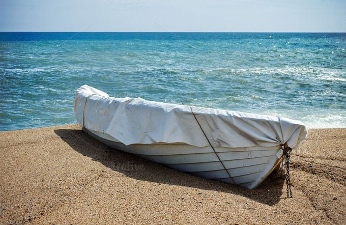 boat on the sand by JCB Photogr@phic on Creative Market