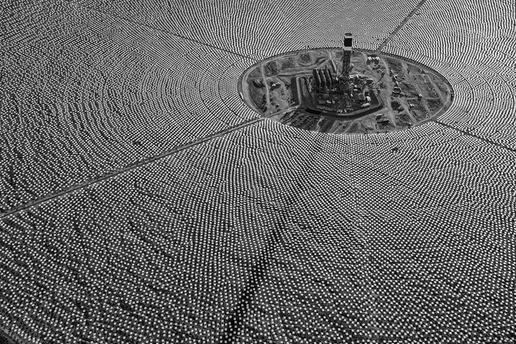 via @nprnews: Completed tower for Solar Field One surrounded by thousands of heliostats. Eventually, they will send concentrated solar thermal energy to the top of the tower, superheating water to create steam and drive turbines.