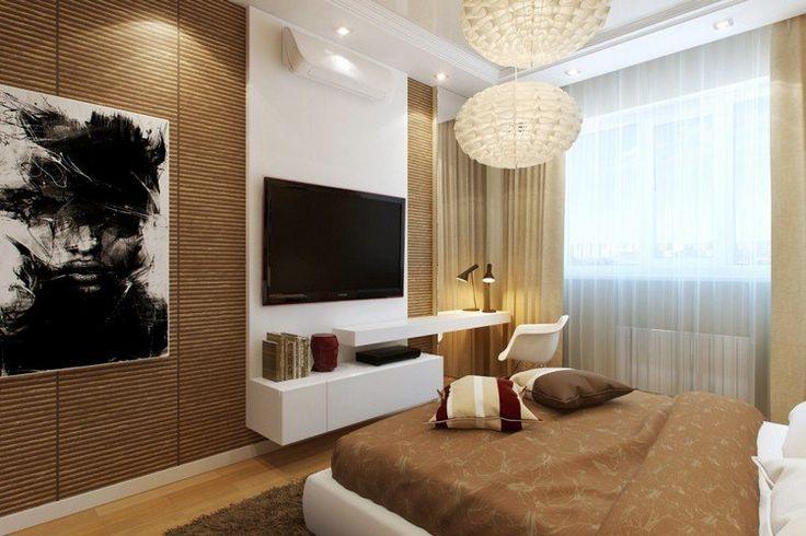 aménagement petite chambre élégante avec un grand lit, un meuble tv mural et un petit coin bureau