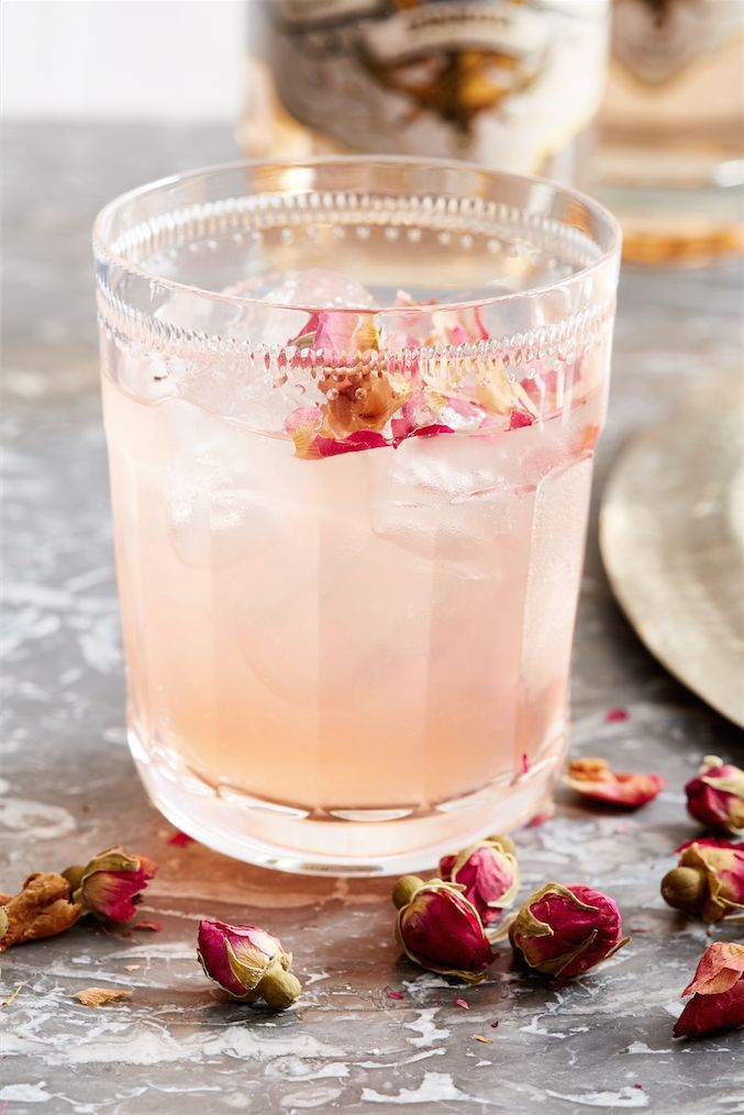 This Gin & Roses cocktail is made with pink gin, rosewater and dried rose…