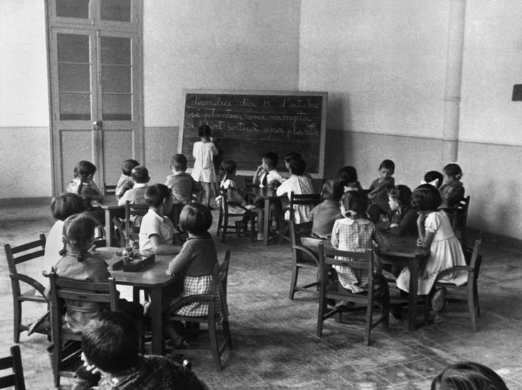 SPAIN. Catalonia. Barcelona. Public schools became secular during the second Spanish Republic (1931-1939). In this school children write their lessons in Catalan. October 193