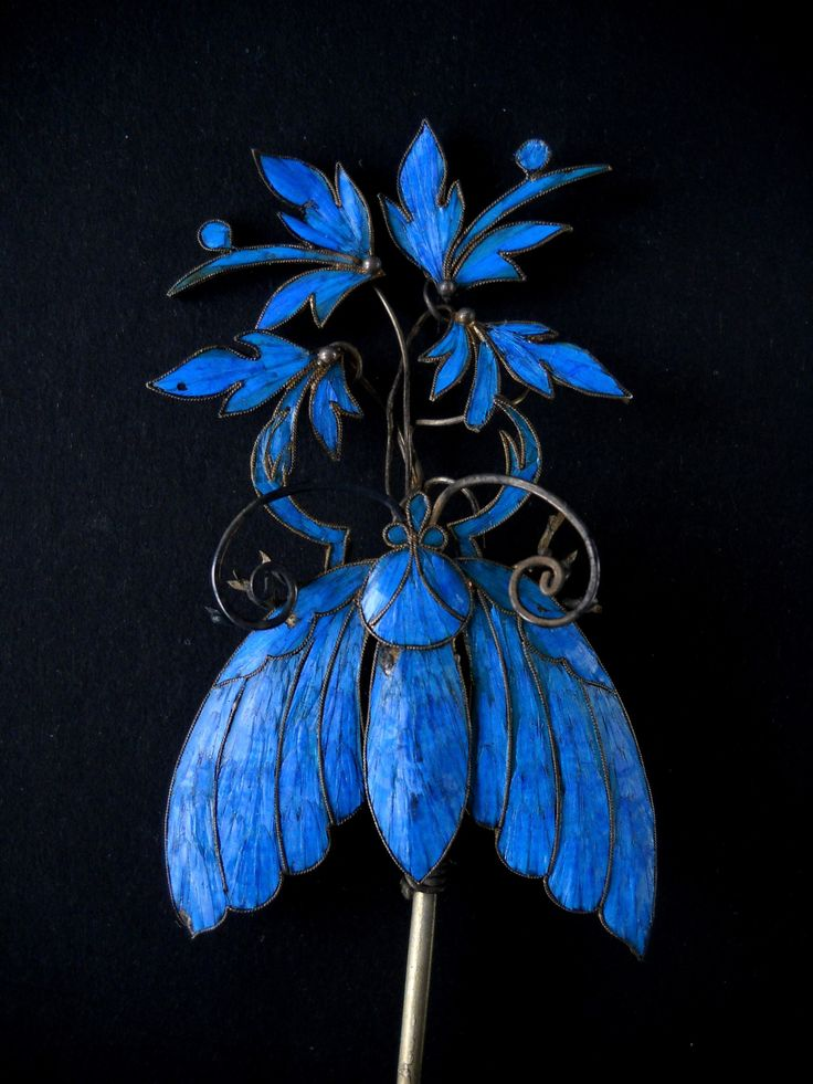 Chinese kingfisher feather hairpin. China has been using blue kingfisher feathers in hairpins as fine art and decoration for 2,000 years