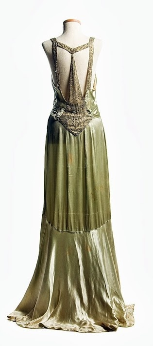 Love the back on this circa 1932 light green satin dress worn by Eleanor Middleton Rutledge Hanson (1894-1966) on her second court visit to Buckingham Palace in 1932.  Via Charleston Museum.