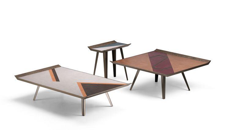 Space invaders  _design Gino Carollo sono tavolini rettangolari o quadrati, ma la loro particolarità si trova nel rivestimento del piano in pelle vegetale, realizzato attraverso il mix di toni naturali e toni più forti, che ricordano le geometrie di texture africane.