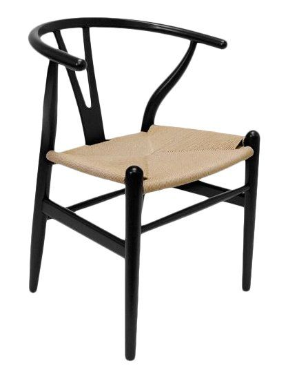 Crafted of solid beech wood and featuring a woven seat, this charming arm chair is perfect pulled up to your breakfast nook for weeknight meals or topped with a plaid pillow to round out a lodge-inspired living room look.