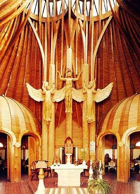 Imre Makovecz~Here is the inside to the Paks Catholic Church. For those familiar with the religion, you can see how he puts in religious symbols throughout the room, but in a different way than we're used to seeing in older Catholic Churches throughout Europe. I absolutely love how he did the skylight on top, and how the wood laces through and around it, as if it just naturally grew that way.